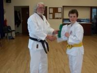 William Receives 6th Kyu Award From Reg