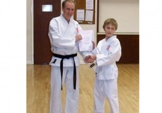 Stanley Receives 8th Kyu Award From Matthew
