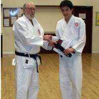 Daniel Proudly Receives His Black Belt