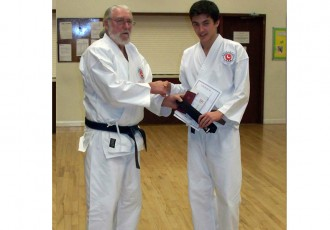 Daniel Proudly Receives His Black Belt