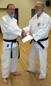 Reg Presents Award To Karate Instructor Matt