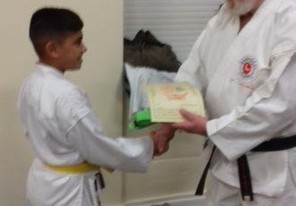 Kartar receives his 6th KYU certificate from Sensei Reg