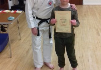James receives his 8th KYU certificate from Sensei Mick