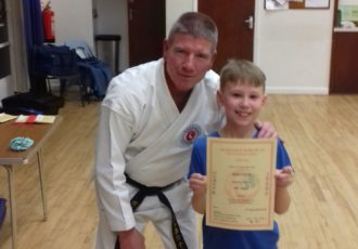 Rory receives his 8th KYU certificate from Sensei Mick