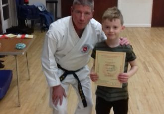 Jenson receives his 8th KYU certificate from Sensei Mick