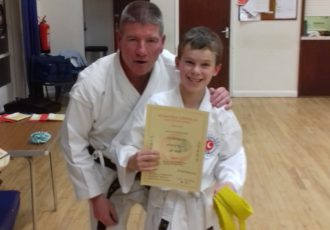 Leo receives his 7th KYU certificate from Sensei Mick