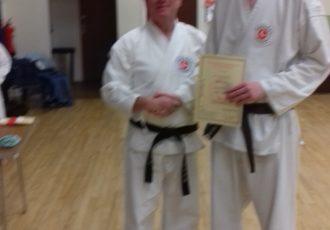 Adam receives his 2nd KYU certificate from Sensei Mick