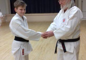 Cadet James Ellis receives his 1st Dan (Shodan)