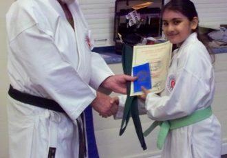 Amrita receives a 5th Kyu from Sensei Reg