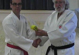 Ian receives 7th Kyu from Sensei Reg