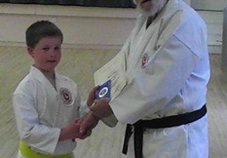 James receives 7th Kyu from Sensei Reg