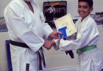 Kartar receives a 4th Kyu from Sensei Reg