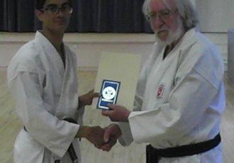 Reece receives 2nd Kyu from Sensei Reg