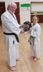 Orla receiving cadet of the year award from Sensei Reg